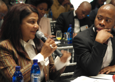 Chimene-Chetty-Director-of-the-Centre-for-Entrepreneurship-at-the-Wits-Business-School,-talking-to-guests-at-the-2014-Lekgotla-on-Youth-Unemployment